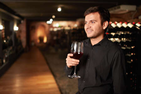 Attractive man with a glass of wine photo