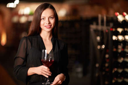woman drinking wine: Beautiful girl with a glass of wine Stock Photo