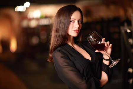 Beautiful girl with a glass of wine photo