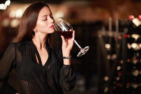woman drinking wine: Beautiful girl drinking wine