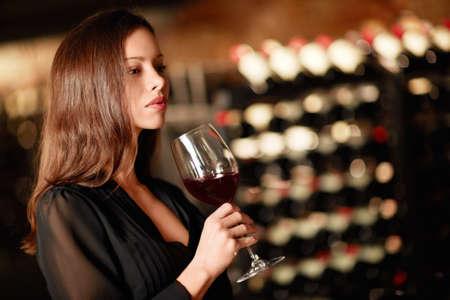 Beautiful girl in the wine cellar photo