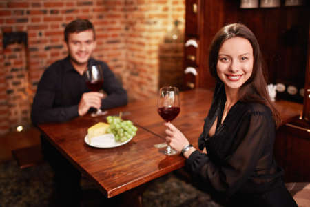 Happy couple with a glass in a restaurant photo