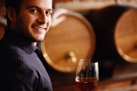 Sommelier and wine from the barrel photo