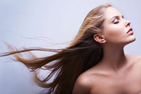 Attractive girl with flying hair photo