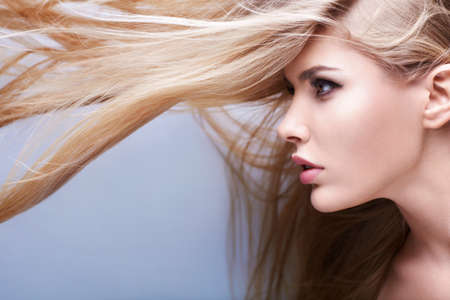 long blonde hair: Young attractive girl with flying hair