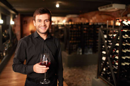 Smiling man in the wine cellar photo