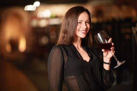 degustation: Attractive woman in the wine cellar Stock Photo