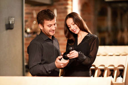 Young couple chooses the wine Stock Photo - 14645751