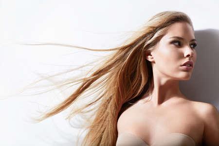 Beautiful girl with shiny hair flying photo