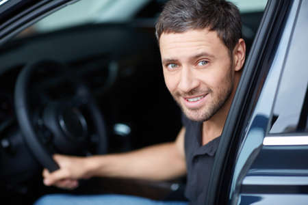 man behind: The young man behind the wheel Stock Photo