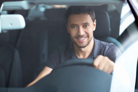 driving: The young man behind the wheel Stock Photo