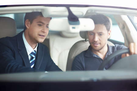 car rental: The man in the car with the seller Stock Photo