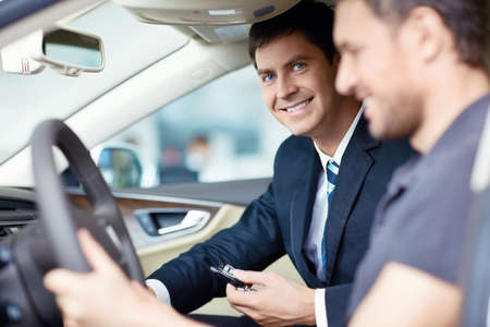 rental car: The man in the car with the seller Stock Photo