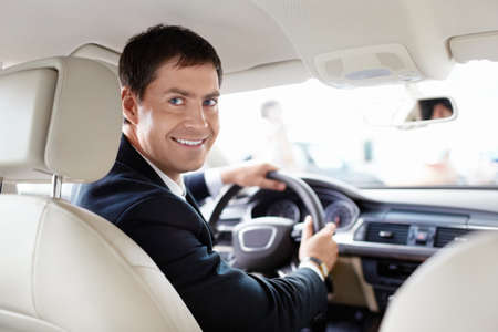 car driver: Seller in a car in a motor show Stock Photo