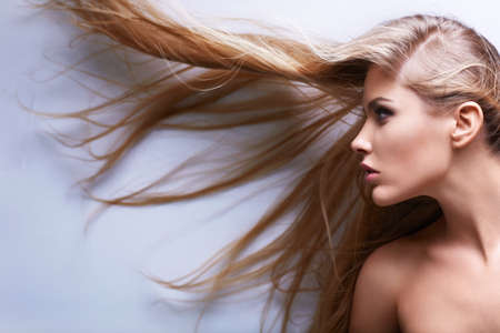blonde hair: Young girl with flying hair