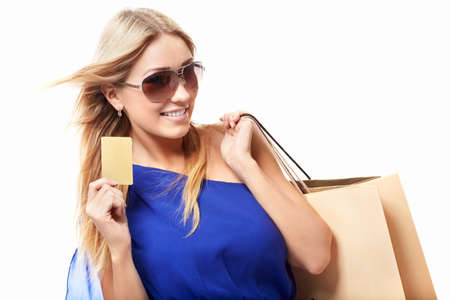 Beautiful girl with a credit card on a white background Stock Photo - 15501833