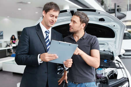 The seller and the buyer in the auto show Stock Photo