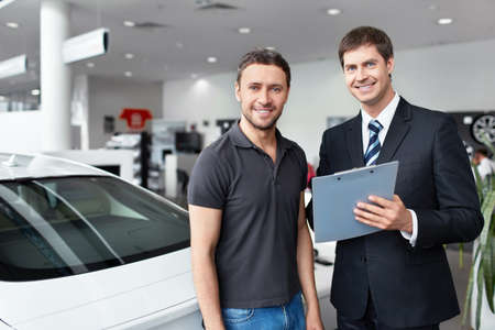 The seller and the buyer in the auto show Stock Photo - 15573156