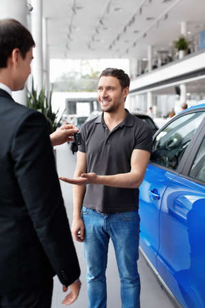 car rental: Seller gives buyer the keys inside the car Stock Photo