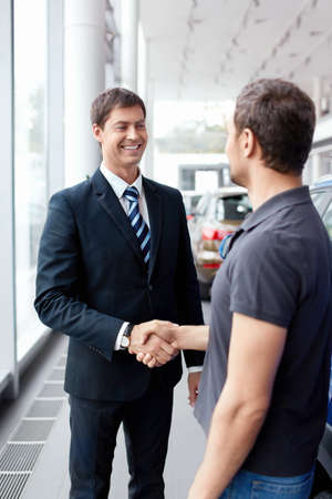Buyer and seller shake hands in the auto show Stock Photo - 15573210