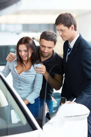 Couple watching a car the salon Stock Photo - 15573201