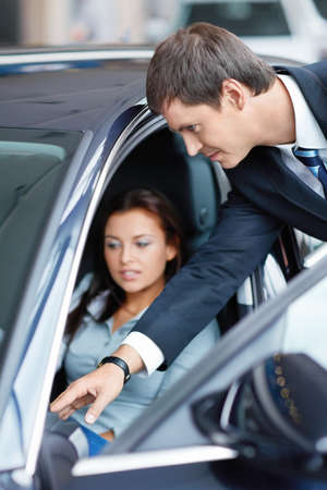 Woman in the car at a showroom photo