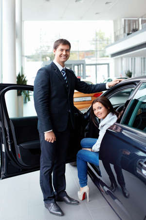 Woman in the car and seller at a showroom Stock Photo - 15573199