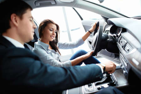 buying a car: Woman in the car and seller