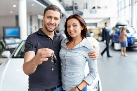 automobile sales: Couple with the keys to car