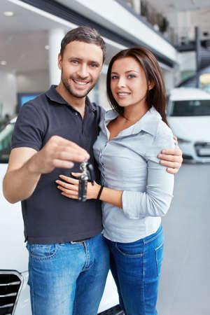 Couple with the keys to car photo