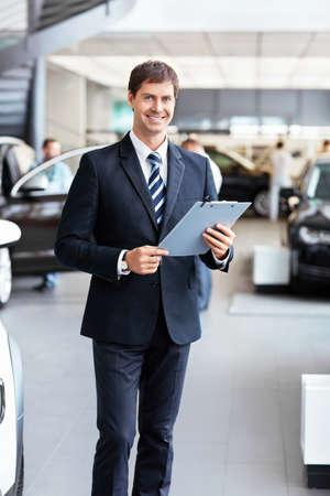 auto dealership: Salesman in the showroom