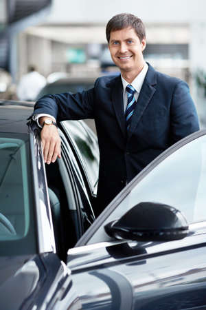 Mature businessman near a car Stock Photo - 15573177