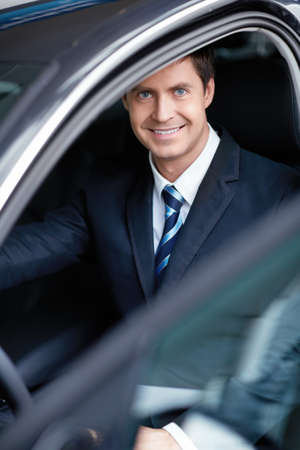 Mature businessman in the car Stock Photo - 15573220