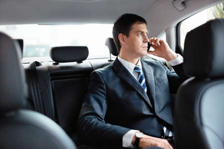 Businessman in car talking on the phone Stock Photo - 15573161
