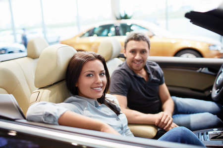 Young couple in a cabriolet photo