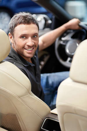 car driving: Young man behind the wheel Stock Photo