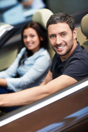 Young couple driving a car photo
