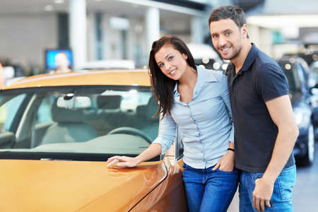 Attractive couple chooses a car photo