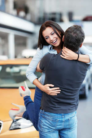 Man picks up on hands of a girl at the car Stock Photo - 15573226
