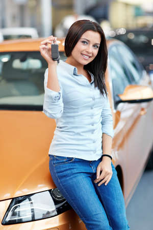 automobile dealership: Beautiful girl with car keys