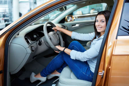 Beautiful girl at the wheel a car Stock Photo - 15573147