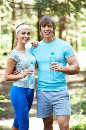 Smiling people with a bottle of water Stock Photo - 15659102