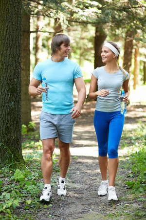 Sports people are running in the park Stock Photo - 15659105