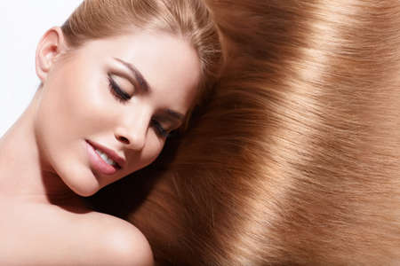 Young beautiful girl with shiny hair photo