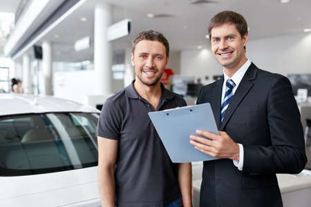 selling service: Buyer and seller about cars Stock Photo