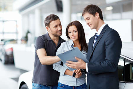 selling service: Seller and buyer in the showroom Stock Photo