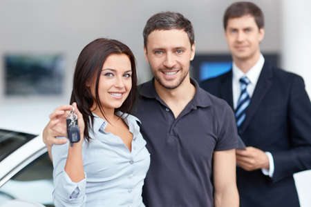 new automobiles: Seller and buyer in the showroom Stock Photo
