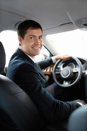 Man in a suit at the wheel photo