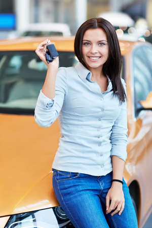 selling service smile: Attractive girl with car keys Stock Photo