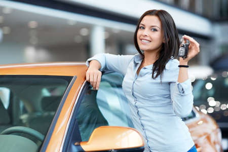 service car: Attractive girl with car keys Stock Photo
